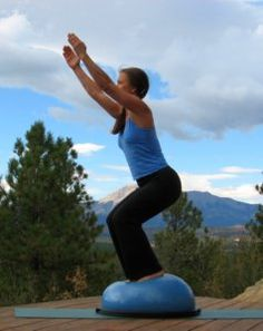 Fierce Pose, or Chair Pose on the Bosu Ball.  This pose is very difficult with the instability of the Bosu Balance Trainer.  It really makes you dig deeply into your core!