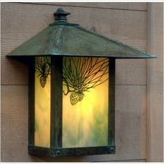 """Arroyo Craftsman EW-12F Evergreen 12"""" Outdoor Wall Lantern with Filigree by Arroyo Craftsman. $348.00. Arroyo Craftsman EW-12F Features: -Evergreen collection. -Available in several finishes. -Available in several shade colors. -Available filigree in Pine Needle, Hummingbird and Sycamore. -UL listed. -Suitable in wet location. Specifications: -Accommodates: 1 x 100W medium incandescent bulb. -Mounting center to top: 8"""". -Overall dimensions: 13"""" H x 11.25"""" W x 7.38"""" D. Note..."""