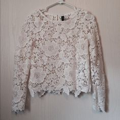 Long Sleeve Lace Top A thick floral white lace long sleeved dressy top in excellent like new condition. It was only worn once to try on.   #floral #lace #sheer #longsleeve #dressy #hm H&M Tops