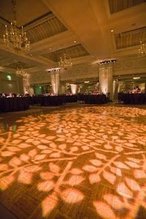 Inexpensive way to add texture and light.  Just incorporate your colors and favorite design. Great idea for the dance floor.