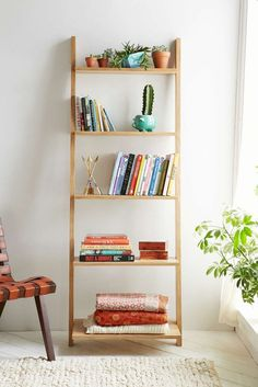 Highlight plants and books with an open bookshelf.