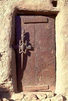 Africa | A Crocodile door lock/handle on a Dogon door. Mali