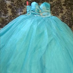 Turquoise prom dress Turquoise prom dress. Size 4 very beautiful does have a stain. Dresses Prom
