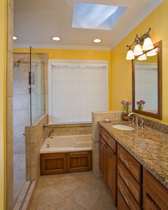 The master bathroom in this whole house remodeling project  Photos by Ray Strawbridge Commercial Photography