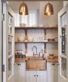 kitchen glow .great white  kitchen. great copper lighting for home or restaurant decor! popuprepublic.com