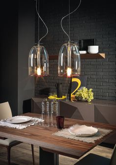 Classic ceiling, floor or table lamp in borosilicate transparent glass with red lower profile and cable. The ceiling version version features a transparent cable.