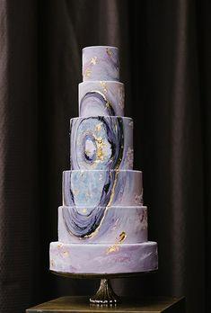 Edible gold flecks add flourish to this agate-inspired wedding cake.