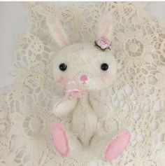 """Posing bunny stuffie mesures 4"""" seated, front including ears. Completely handmade from mohair fabric.Please allow up to 10 days for this item to ship as it is made to order."""
