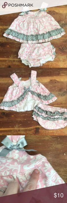 Baby Essentials 9M Pink Paisley Outfit w Satin Bow Adorable outfit is perfect for warm weather. Pink and gray paisley design with Grey satin bows. The ruffle bottoms add a special touch. In good condition. There is a small hole which is shown in picture. It could be closed up with a few stitches. Otherwise this outfit is in great condition. Baby Essentials Matching Sets