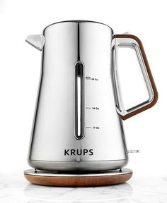 Krups Chrome & Wood BW600 Electric Kettle Smart-looking, this sophisticated electric kettle brings style and top service into your space. The shimmering stainless steel, chrome and wood optics construction catches the eye and makes serving a spot of tea completely effortless with a 360º rotational base, cordless design and automatic opening. Macy's $119.99