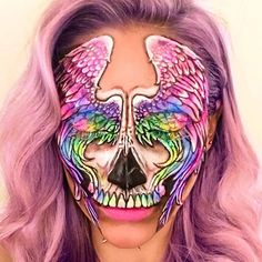 Unicorn / Pegasus Wings Skull I'm jumping on the Instagram Unicorn band wagon and you guessed it- incorporated a skull in there. I just love anything holographic or rainbow. (Pegasus was white, not rainbow but I chose to leave out the horn and some unicorns do have wings you know) What would you name it? Products Used: @wolfefaceartfx Face Painting FX palette, @maccosmetics @maccosmeticsuk Mechanical eyebrow pencil in 'Stud' to do the outline and pressed eyeshadows (depotted, disc...