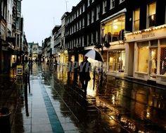street scene on a rainy day on a sunset