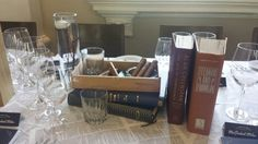 Cigars books and whiskey in a table centerpiece