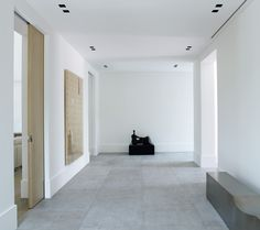 contemporary entrance hall, white grey and blonde wood with black accent - Piet Boon Styling by Karin Meyn |