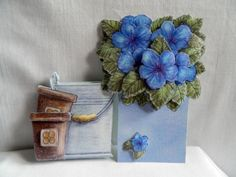 Blue pansies in a silver bucket with flowerpots greeting card.