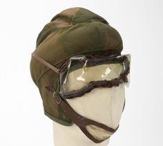 Parachute Helmet, camouflage pattern (with goggles): SOE. Allied agents of the SOE that were parachuted into occupied territory were issued with a set of protective overalls and a fabric jump helmet, both made of a distinctive and unique camouflage pattern. Intended to be used only once, they were buried or otherwise disposed of when landed alongside the parachute; the agent then went along on his or her way clothed in civilian attire to blend in anonymously.