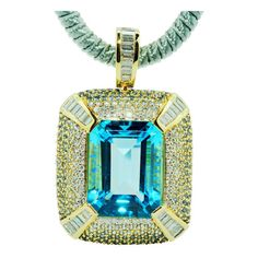 ROBERT WANDER Blue Topaz Sapphire Diamond Pendant  | From a unique collection of vintage drop necklaces at https://www.1stdibs.com/jewelry/necklaces/drop-necklaces/