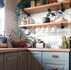 I love the color of the cabinets with the copper hardware.