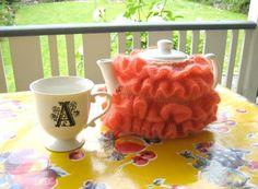 orange frilly tea cozy