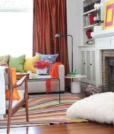 Turn up the volume on a neutral living room with budget-priced bright accents and accessories.