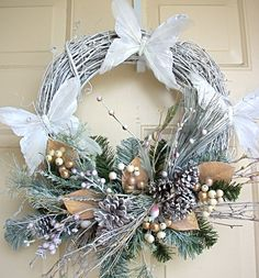 This beautiful twig wreath is full of a large spray of pine branches, pine cones, leaves, white butterflies, and golden berries. Aprox. 20Dia. x 6D