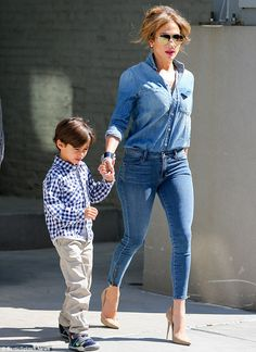 Stepping out: Jennifer Lopez spotted taking her two children Max and Emme to her old school in the Bronx, on Thursday