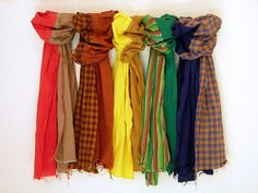 <b>Instead of throwing out old flannel shirts and scarves your sick of, cut, dye, sew, embellish and re-use them to keep your neck toasty this winter.</b>