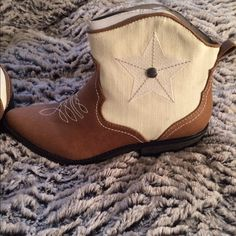 American rag ankle boots Tan brown and white with star decor on side. New with tags. Without original box. Minor handling. Heel size 3/4 in - 1 1/2 in. American Rag Shoes Ankle Boots & Booties