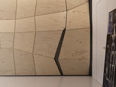This faceted wall hides the bathroom