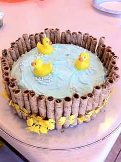 Make way for duckling - add duck cupcakes making their way to the pond