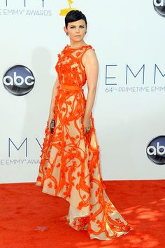 Known fashionista Ginnifer Goodwin didn't disappoint in a dramatic orange and white Monique Lhuillier gown.