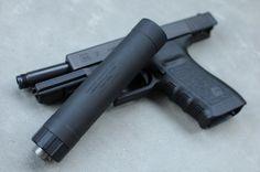 Glock 21 pistol and suppressor, I personally love suppressors, sounds like plinking! ;)