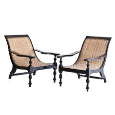 Anglo-Indian Plantation Chair in Ebony | From a unique collection of antique and modern lounge chairs at http://www.1stdibs.com/furniture/seating/lounge-chairs/