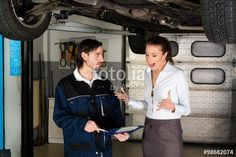 Car mechanic with angry female customer