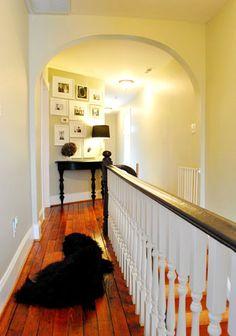 This could have been an awkward nook at the top of the stairs but looks awesome with the picture vignette & table.