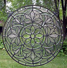 pretty leaded round window. http://www.stainedglassandmore.com/