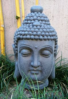 Cast Stone Buddha Head Statue - Basalt Finish. Height: 40cm, Width: 23cm, Depth 24cm. Weight: 13 Kgs. Guaranteed Weatherproof.