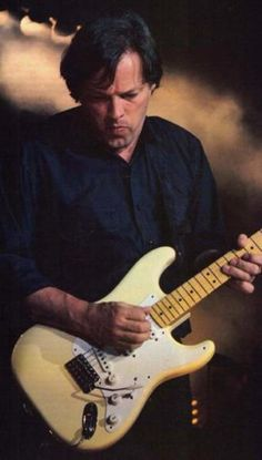 David Gilmour: A rare cream-colored Strat for him and from his looks, probably an 80s photo. Obviously from his experimental phase with a mod bridge, likely to make his extensive use of tremolo easier.