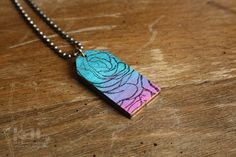 Hand Painted Wooden Tag Necklace in Teal, Aqua, Purple and Pink with Black Stamped Rose Petal Pattern #rosequartzserenity #handmade #tagnecklace