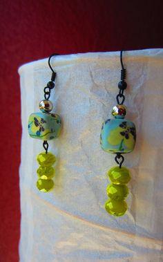 Handmade bright and beachy clay and glass beaded earrings. $15.00, via Etsy.