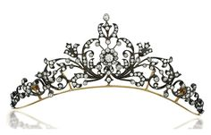 A LATE 19TH CENTURY DIAMOND TIARA NECKLACE Of scrolling floral and foliate design, with central old brilliant-cut diamond cluster among a similarly-set graduated openwork panel, raised on a plain frame with detachable backchain, mounted in silver and gold, circa 1890