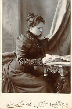pensive and pretty lady reads a book in London cabinet photo +~+~ Antique Photograph ~+~+ Young woman reading. Victorian London, Victorian Photos, Vintage London, Victorian Women, Old London, Edwardian Era, Antique Photos, Vintage Pictures, Vintage Photographs