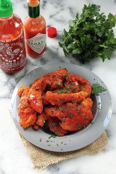 Spicy Sriracha Chicken Fingers - Spicy, Saucy, and Totally Addicting! If you love spice, you'll love these chicken fingers!
