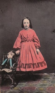 Young girl in reddish dress. Early colorised photo.