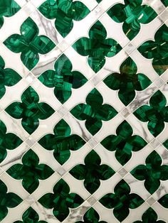 Artistic Tile is a family run business that offers full service custom capabilities. Cut with water jet precision, this beautiful mosaic features malachite, marble and mother of pearl.