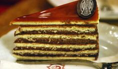 Dobos torte is a Hungarian cake featuring a five-layer sponge cake, layered with chocolate buttercream and topped with thin caramel slices. Hungarian Desserts, Hungarian Cake, Hungarian Cuisine, European Cuisine, Hungarian Recipes, Austrian Cuisine, Kosher Recipes, Gourmet Recipes, Pastry Recipes