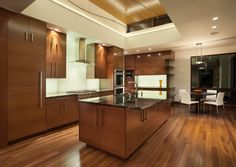 I like the handles. I also like the wood of the cabinets but I think I rather have the grain be vertical.