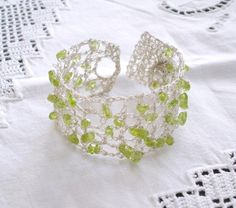 Crochet Wire Jewelry Lace Silver, Green Gemstone Peridot Bracelet, Bridesmaid Jewelry, Spring, Fall Autumn Bride, Bridal Jewelry. $68.00, via Etsy.