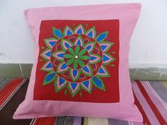 "Hand Embroidered cushion cover by rural women of a small NGO ""Aham Bhumika "" based in Bhopal.If intersted to support by buying than mail us ahambhumika@gmail.com"