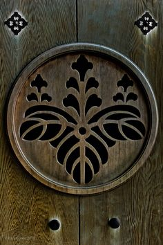 Carved Japanese Family Crest (mon)  - Mon (also called kamon) are symbols and imagery used to identify a family name or institution, similar to the coats of arms in European heraldic tradition.  In Japan, mon can be found on many items associated with a particular family, including kimono, fukusa, noren, and even roof tiles of the family home.
